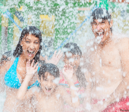 family getting splashed at the water park